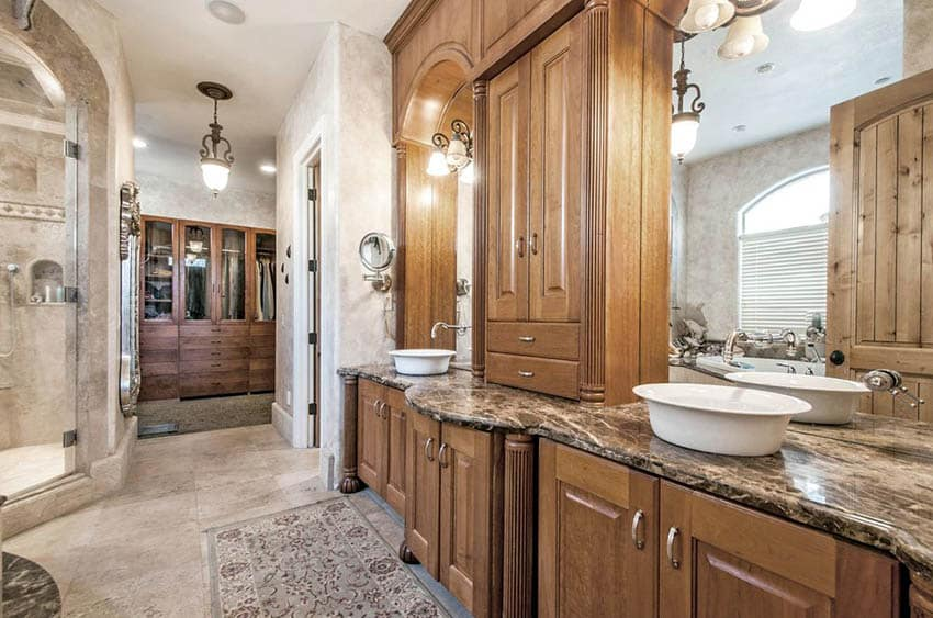 Master bathroom with dark Emperador marble countertops