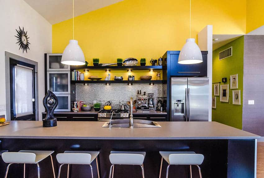 Modern kitchen with dark cabinets and bright yellow accent wall