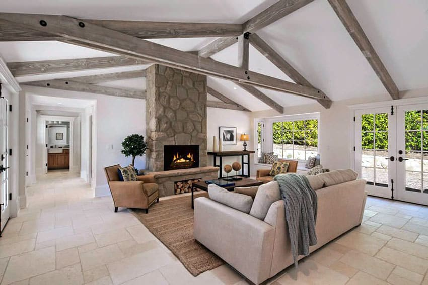 Rustic farmhouse living room with vaulted ceiling and tile floor