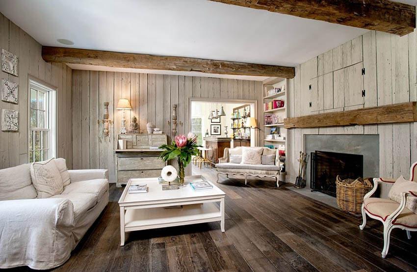 Rustic farmhouse living room with wood panel walls reclaimed wood beams and hardwood floor