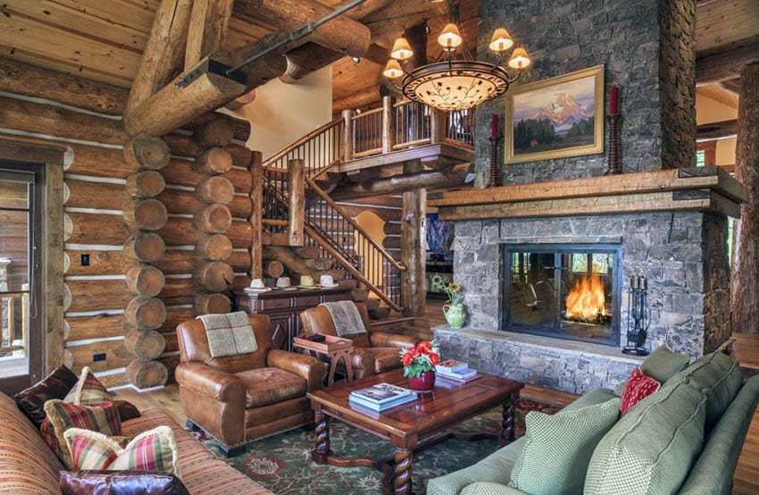 Rustic living room in log cabin home with stone fireplace