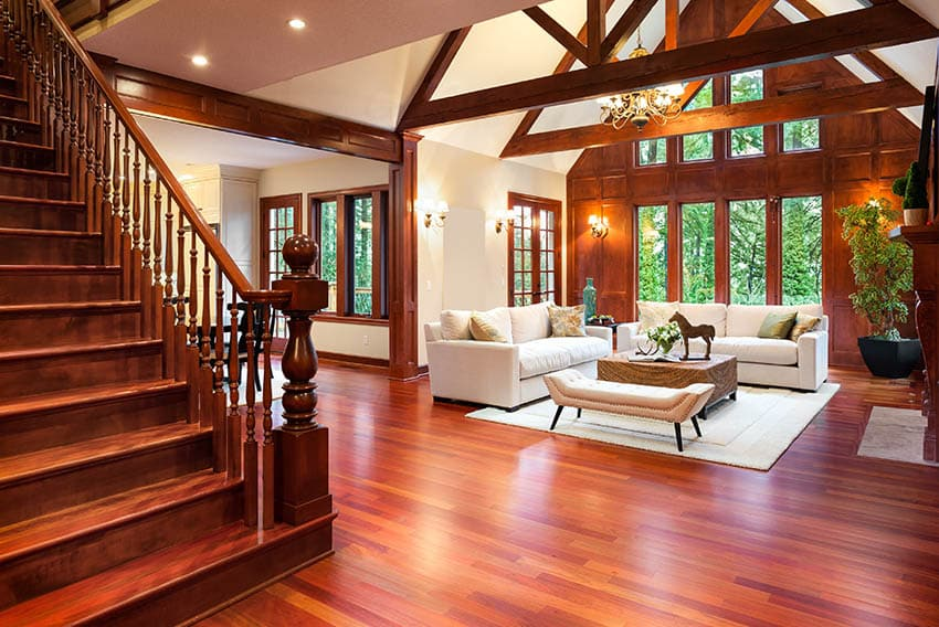 Rustic living room with wood floors cathedral ceilings and wood panel wall
