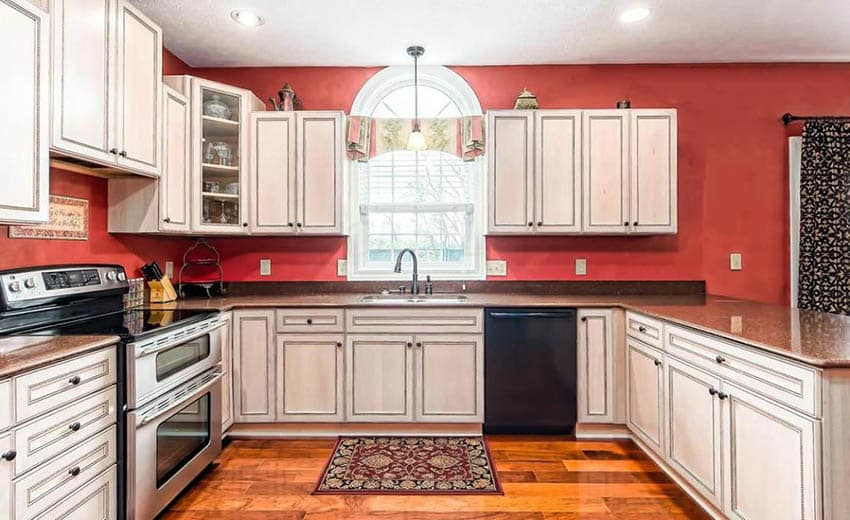 Traditional kitchen with distressed cabinets and ablaze red paint