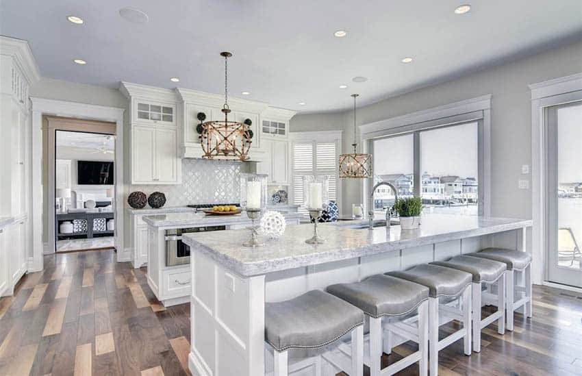 Transitional kitchen with double islands, white cabinets, light gray paint and walnut hardwood flooring