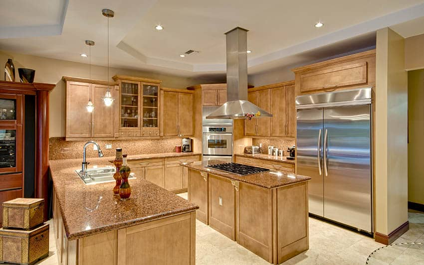 Wood cabinet kitchen with beige painted walls and travertine tile floors
