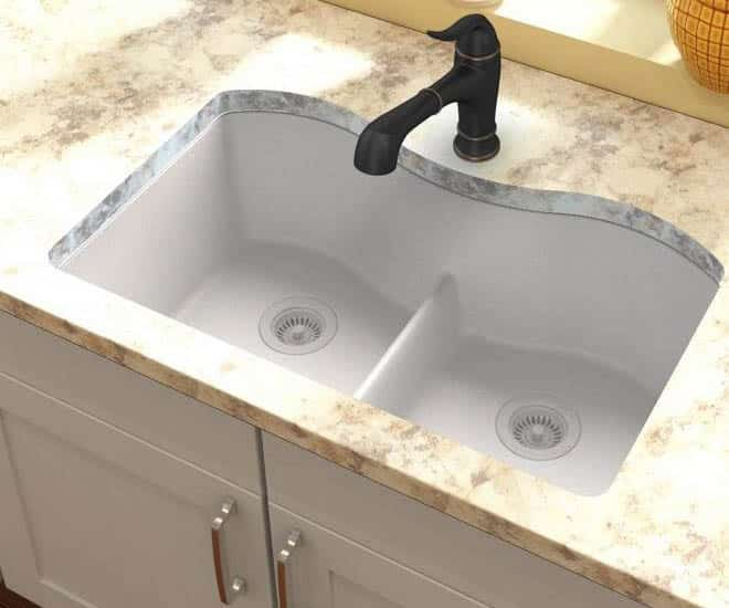 Kitchen with double basin sink with low divide