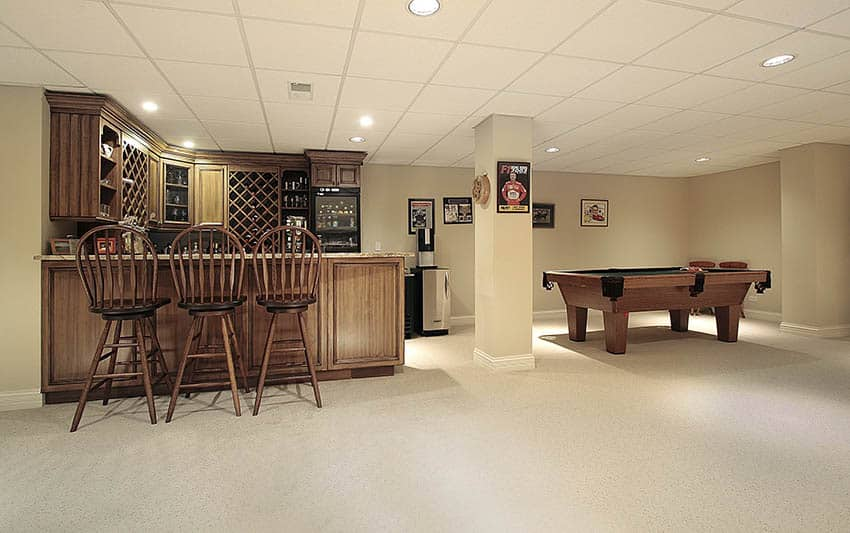 Basement game room and bar with epoxy flooring