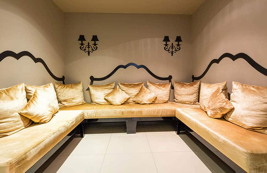 Basement lounge with porcelain tile flooring and wrap around wall couches