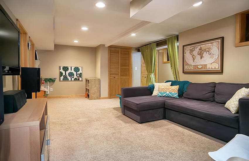 Basement with beige carpet and recessed lighting