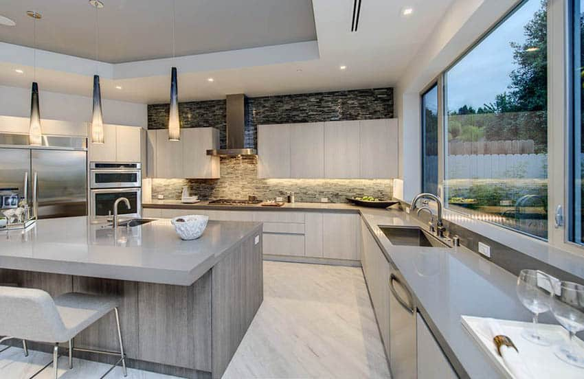 Contempoary kitchen with solid surface counters and sink