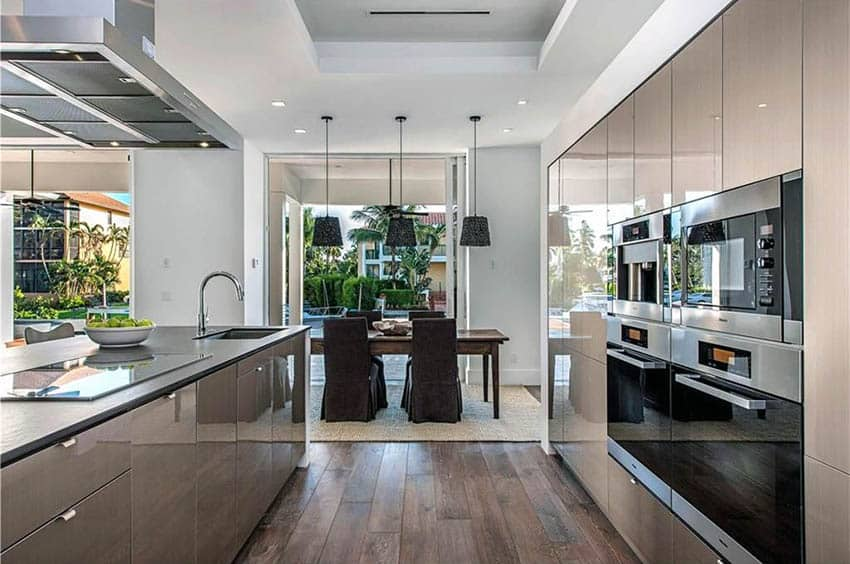 Contemporary kitchen with acrilux european cabinets with edge tab pull door hardware