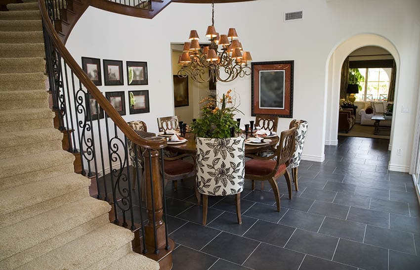 Dining room with rustic chandelier and arched doorway