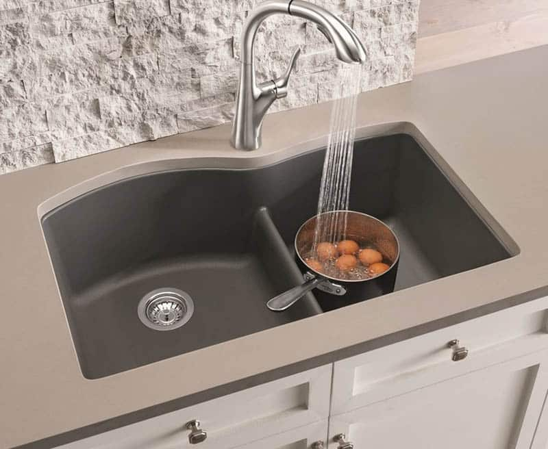 Granite composite kitchen sink with low divider