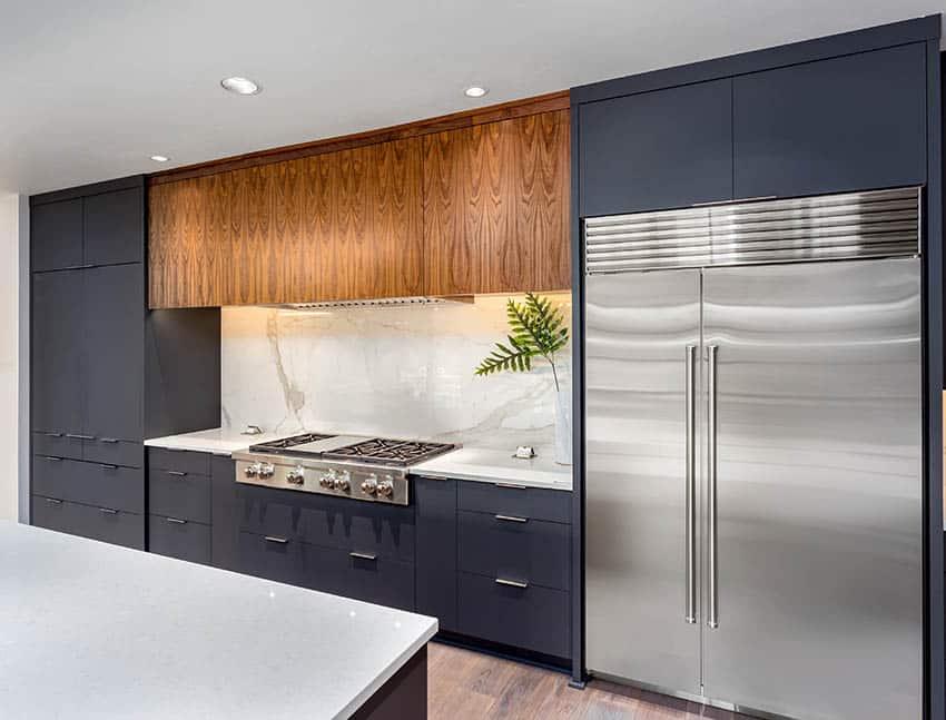 Kitchen with dark european cabinets and white quartz countertops