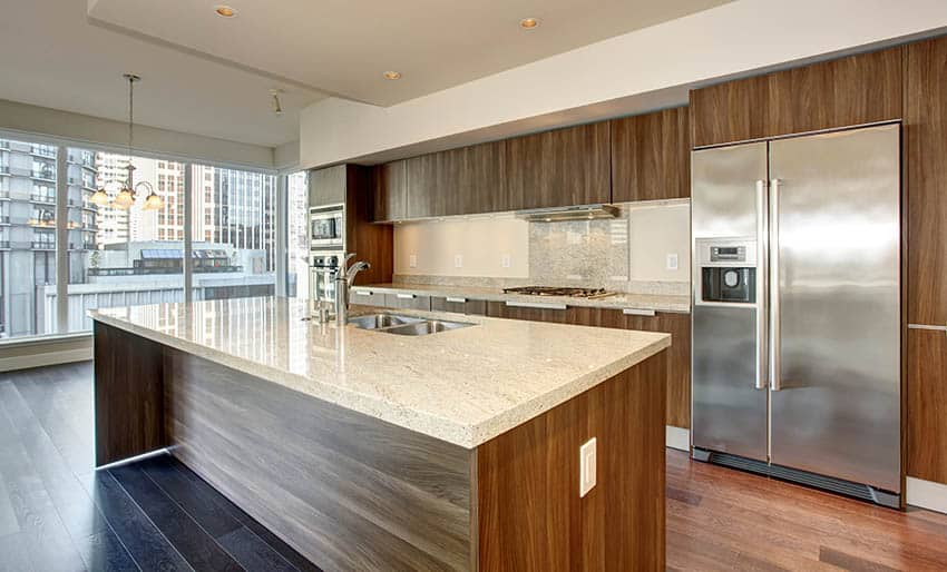 Kitchen with european style full access cabinets and rectangular island