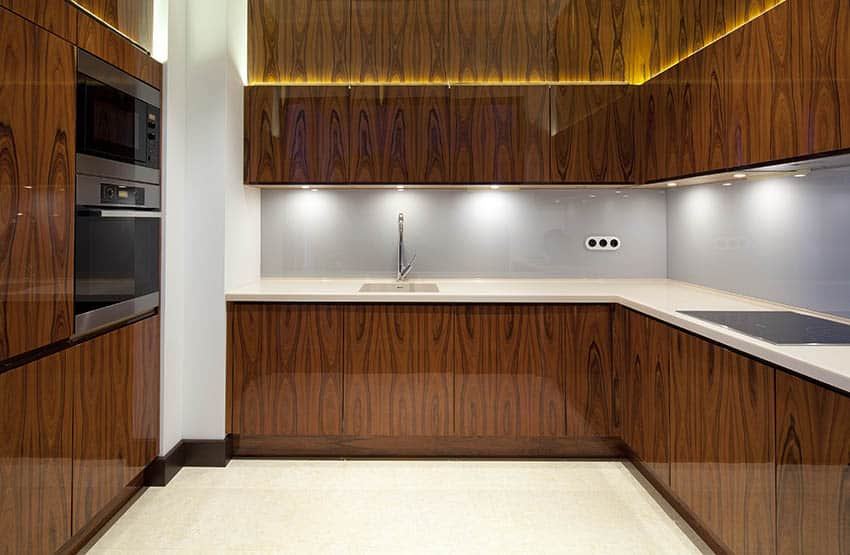 Kitchen with veneer wood cabinets and push to open hardware