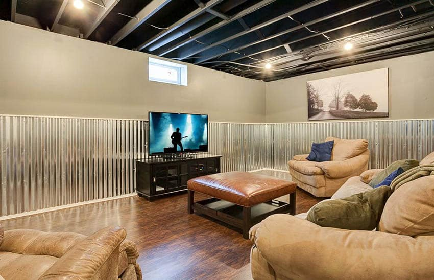Lounge basement with hickory wood plank vinyl flooring and corrugated steel wall panels
