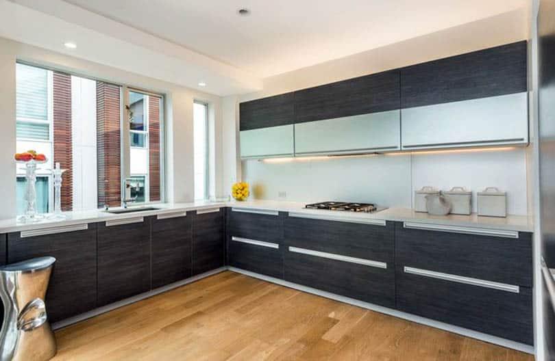 Modern kitchen with dark gray european cabinets with c channel door hardware