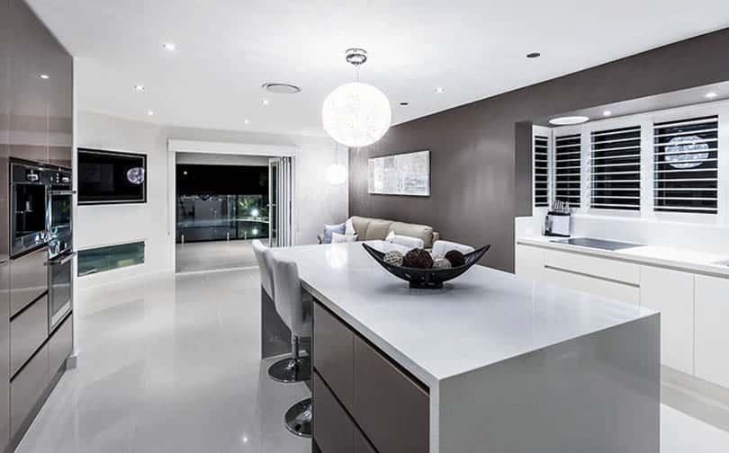 Modern kitchen with dark gray european cabinets with integrated door hardware