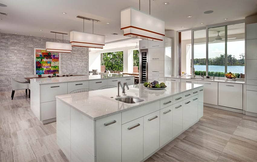 Modern kitchen with retractable handle sink–in island with white marble counters