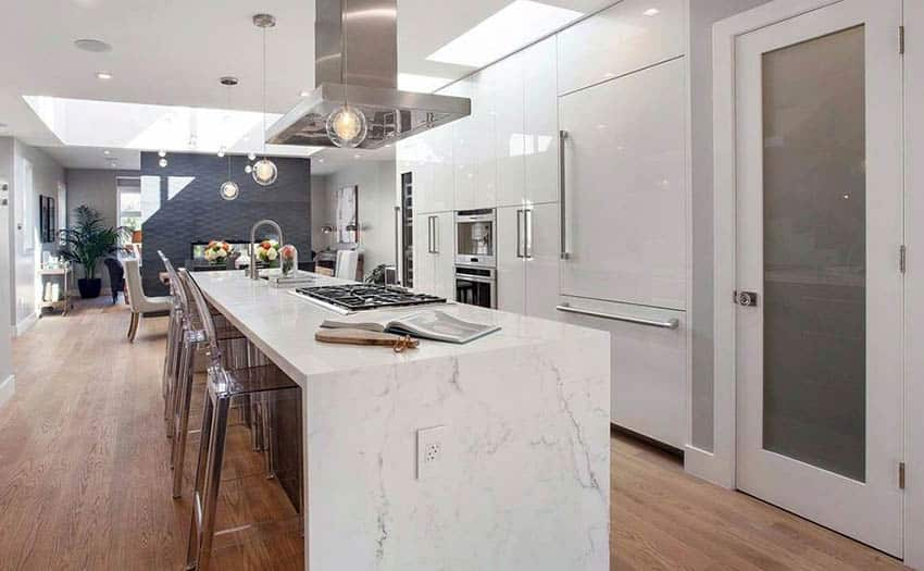Modern kitchen with white lacquer cabinets and calacatta marble island and miele built in appliances