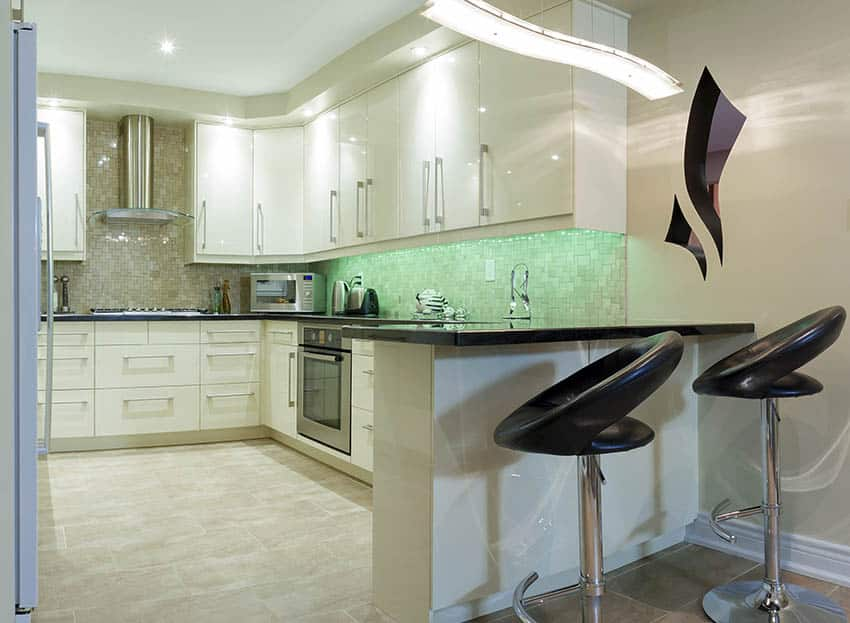 Modern white cabinet kitchen with polished metal pull door hardware