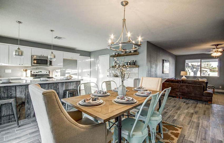 Rustic transitional dining room with hoop style chandelier pendant kitchen island lights