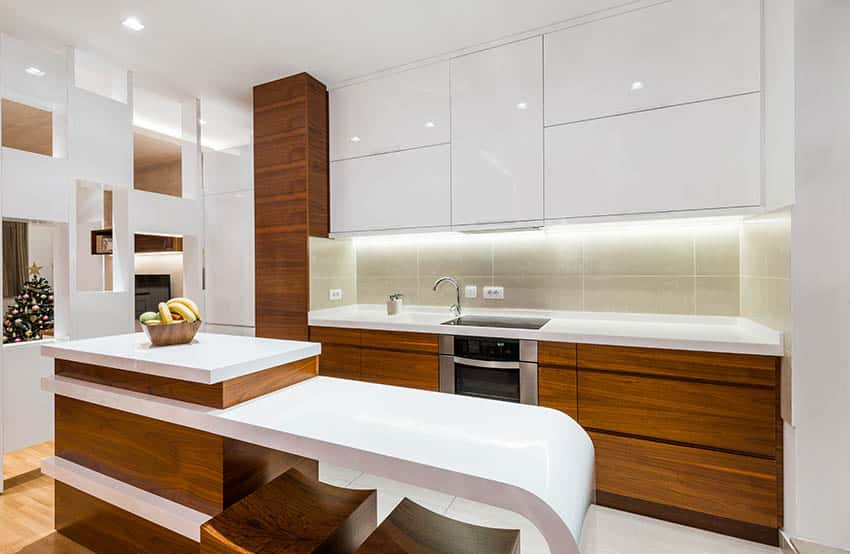 Small modern kitchen with white cabinets brown cabinets and breakfast bar