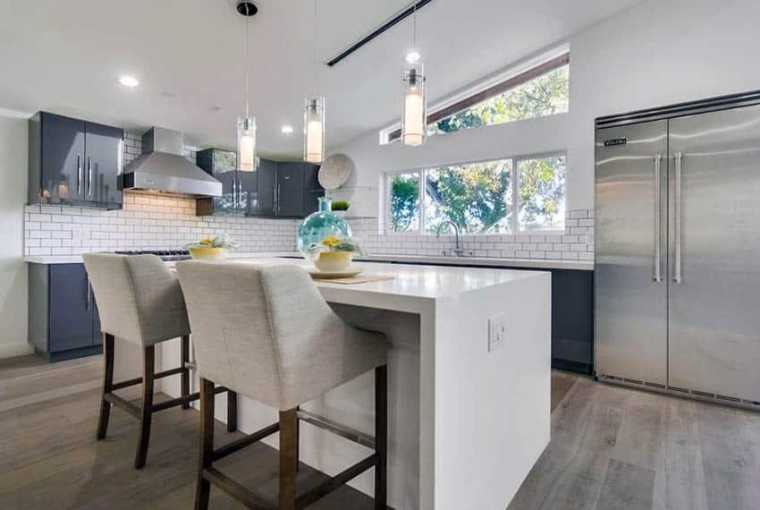 Transitional kitchen with acrylic cabinets and white tile backsplash