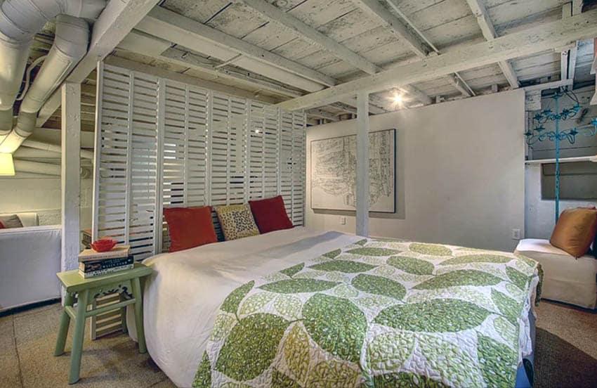 Basement living room bedroom combo with built in wood slat divider
