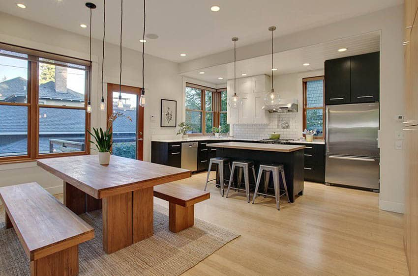 Contemporary kitchen with prairie grass color paint dark european cabinets and light wood floors