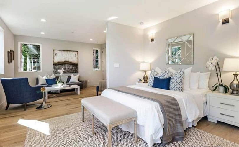 Contemporary living room bedroom combo with light wood floors