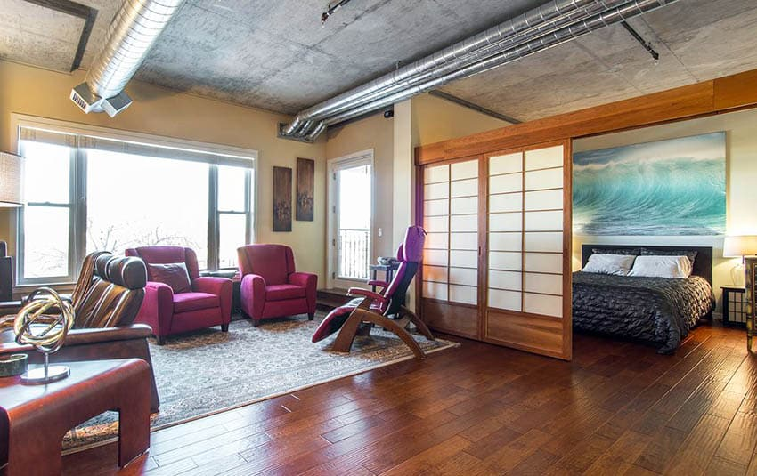 Japanese style living room and bedroom combo behind shoji doors with bamboo flooring