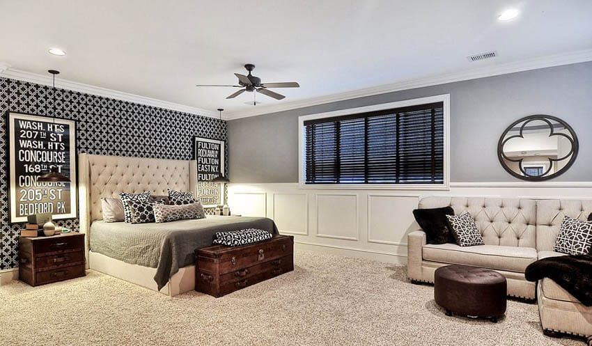 Living room bedroom combo with gray paint beige carpet and tufted platform bed