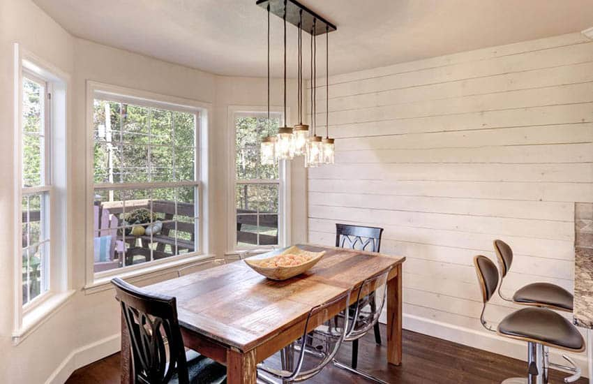 rustic-dining-room-with-painted-shiplap-wall-and-wood-table