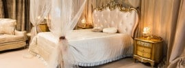 luxury-bedroom-with-sheer-four-poster-canopy-bed-gold-decor