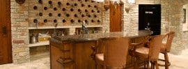 home-bar-in-basement-with-stone-wine-storage