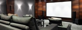 black-grey-home-theater-with-brown-accent-wall