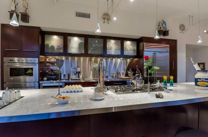 Contemporary dark cabinet kitchen with granite countertops light color