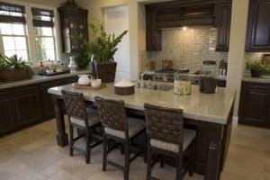 dark-wood-cabinet-kitchen-with-light-granite-counter-rattan-bar-stools