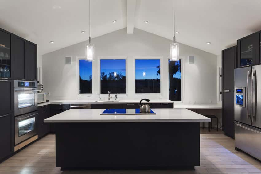 Arched ceiling in modern kitchen with large center island