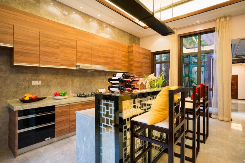Long modern kitchen with bar island
