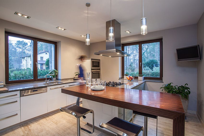 Modern kitchen design with white cabinetry and grey granite