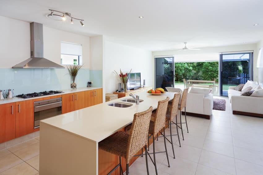 Orange modern kitchen with blue back splash
