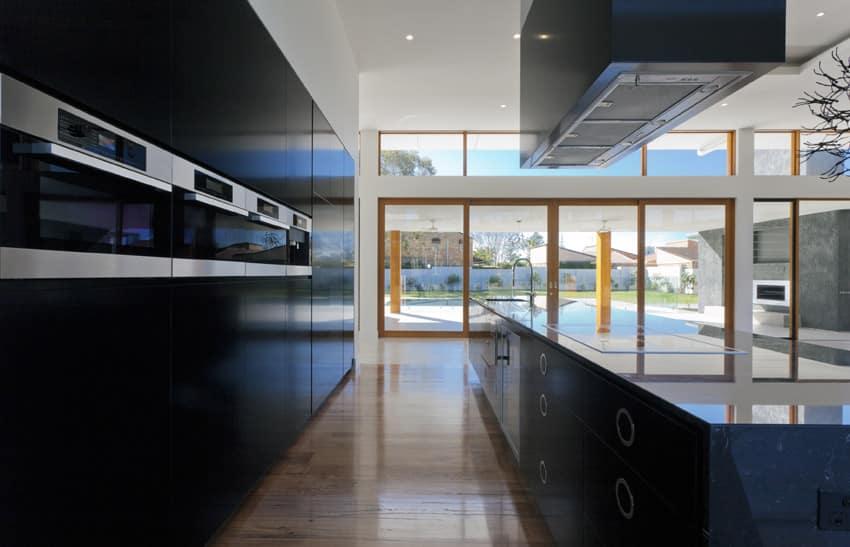 Sleek black modern kitchen with view