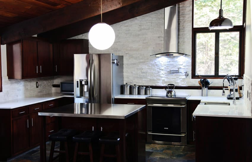 Vaulted ceiling modern kitchen with round light fixture