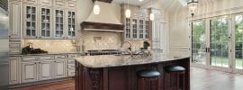 luxury-kitchen-with-large-dining-island-white-cabinetry