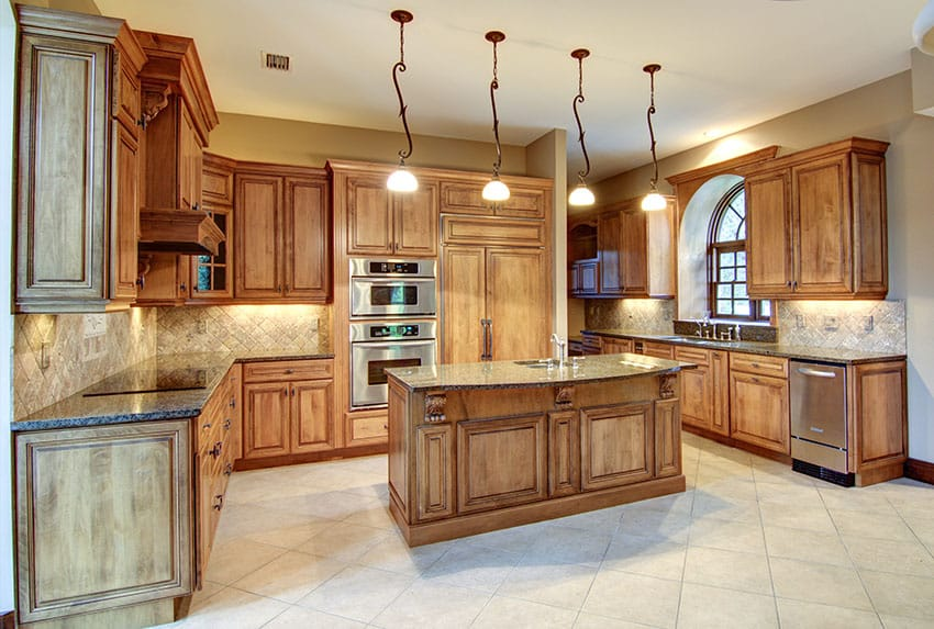 Contemporary Kitchen With Wood Island, Tile Flooring, And Decorative  Pendant Lights