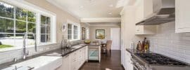 traditional-galley-kitchen-with-white-cabinets-backsplash