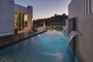 37 Swimming Pool Water Features (Waterfall Design Ideas)